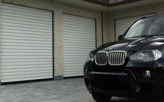 Rolovací garážová vrata Minirol jsou pro dům jako štít