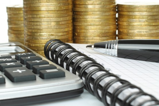 Stationery with stack of coins