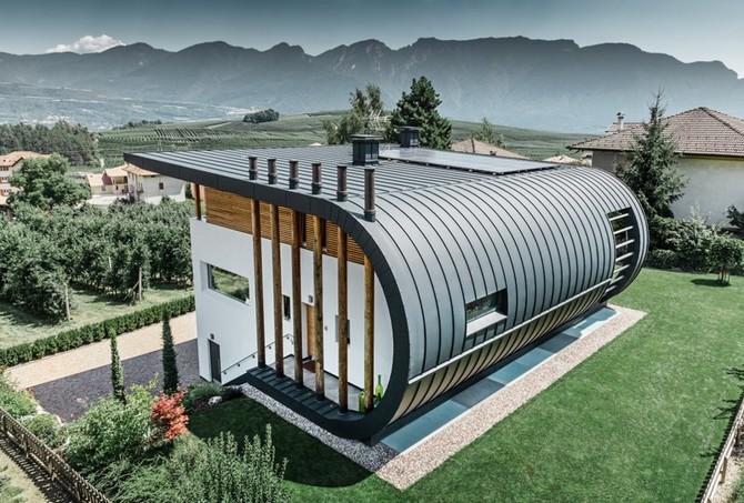 Dům evokuje ochranný štít ve tvaru dlaně